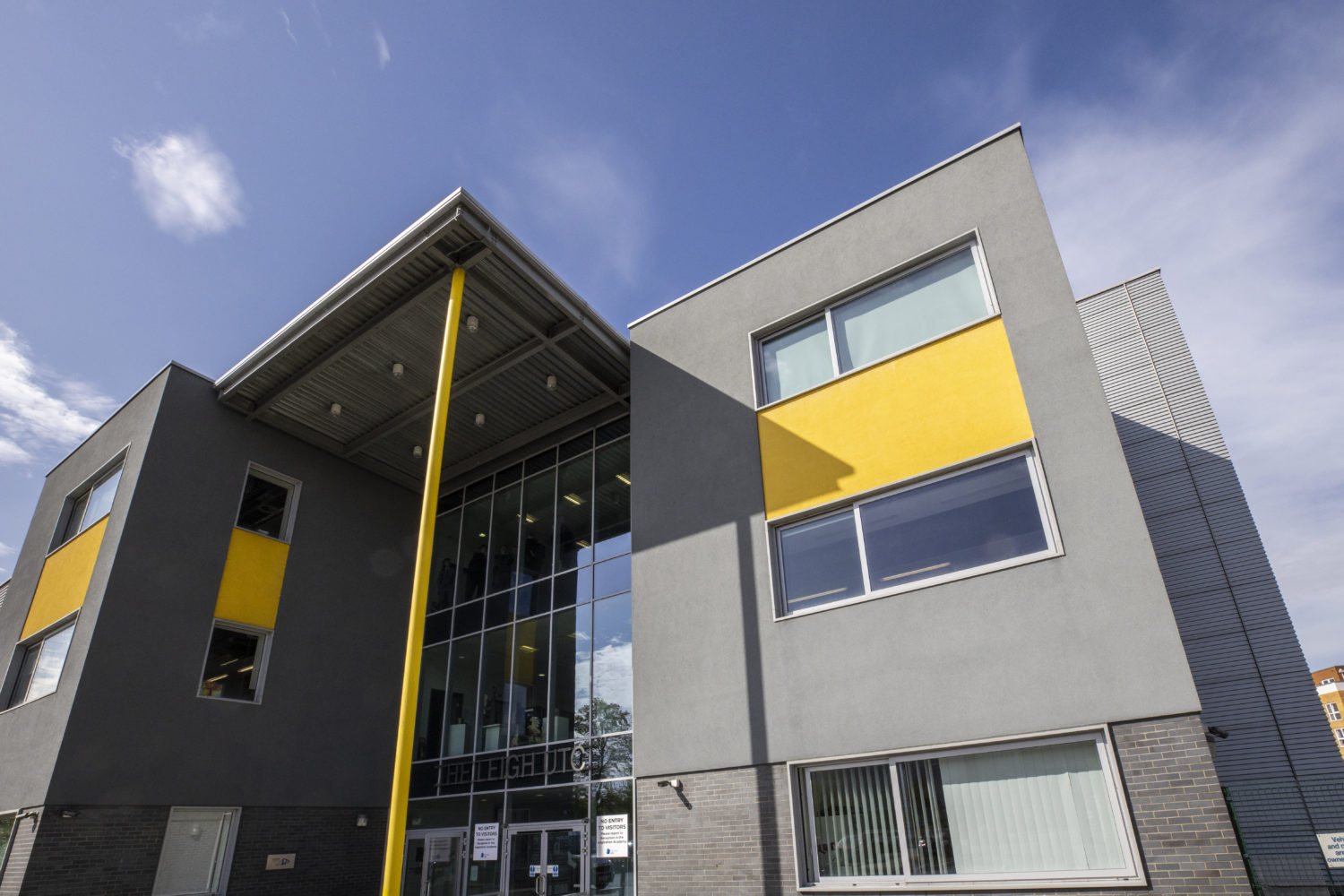 A photo of the outside of The Leigh UTC building.